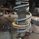 broken transit front coil spring repair